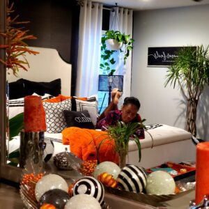 black woman on bed luxury bedroom