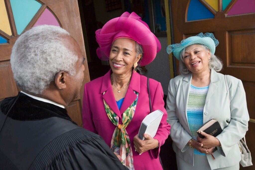 black pastor with black women church goers religious trauma spiritual wounds spirituality