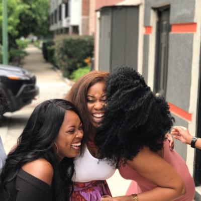 Black women in group happy